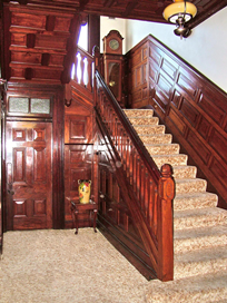 Photograph of the wooden panelled ceiling and stair at Glenarrol